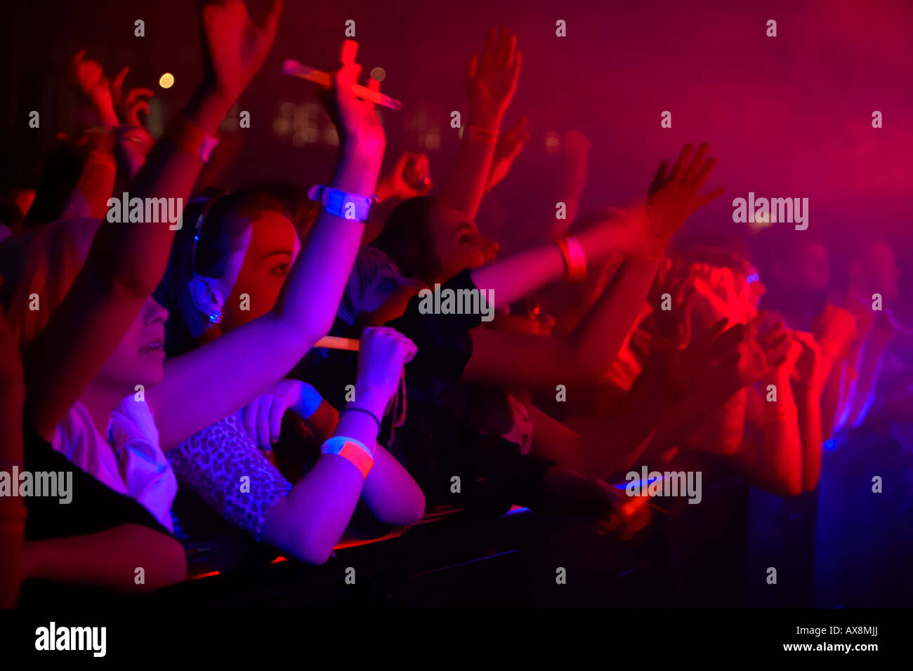front row of a concert full of young women waving in the air at a dance event in Belfast Northern Ireland - Stock Image