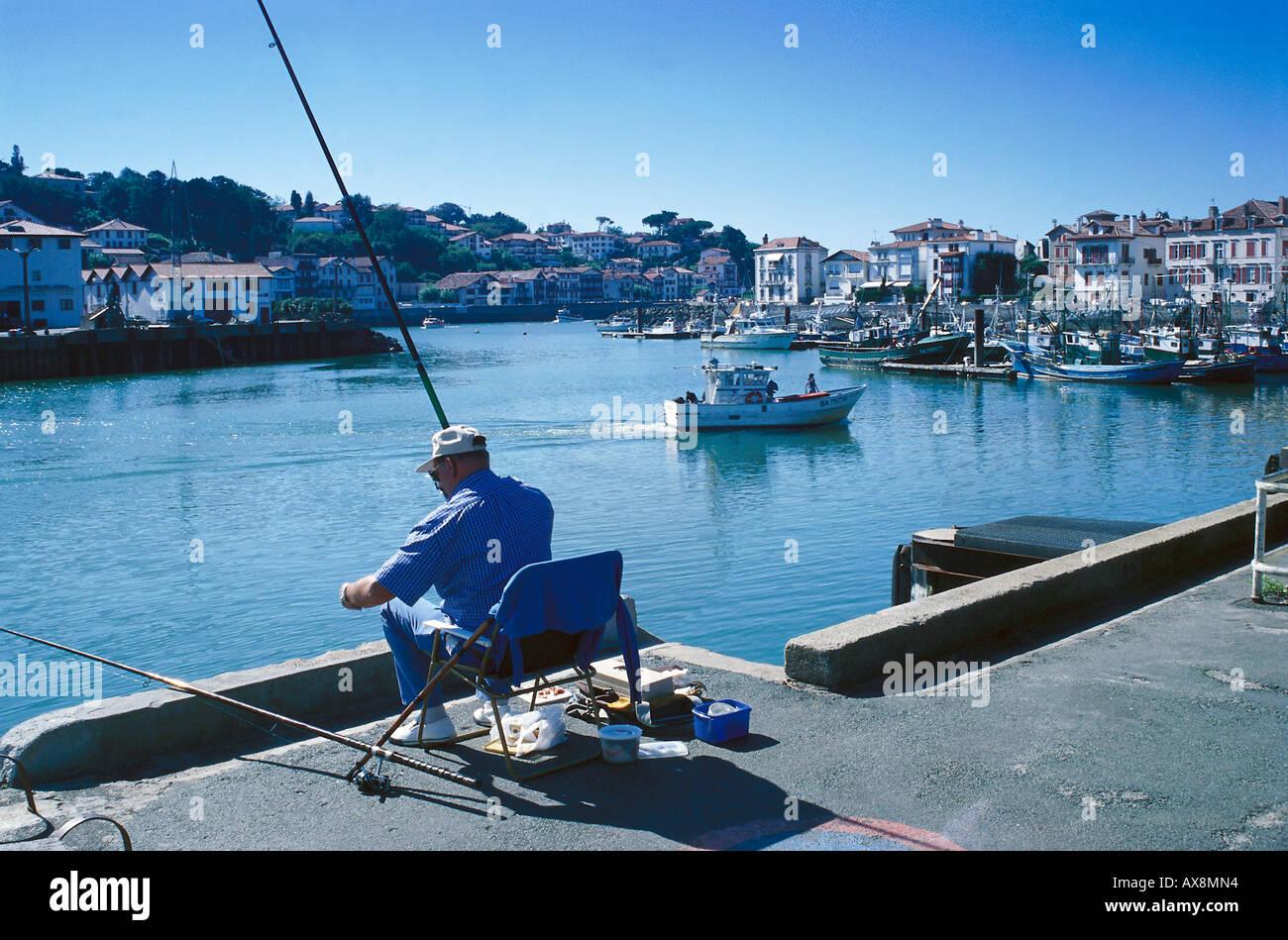 Fisher, St. Jean-de Luz, Pays Basque France - Stock Image