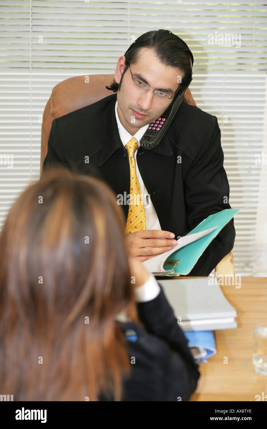 Employer talking interview of a woman in an office - Stock Image
