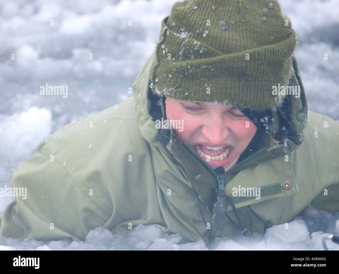 Frederick in the frozen fjord water at minus 2C learning what it feels like to go through the ice Chest deep in - Stock Image