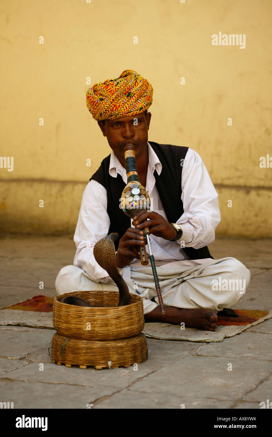 A snake charmer outside the city palace in Jaipur Rajasthan. Picture by James Boardman Stock Photo