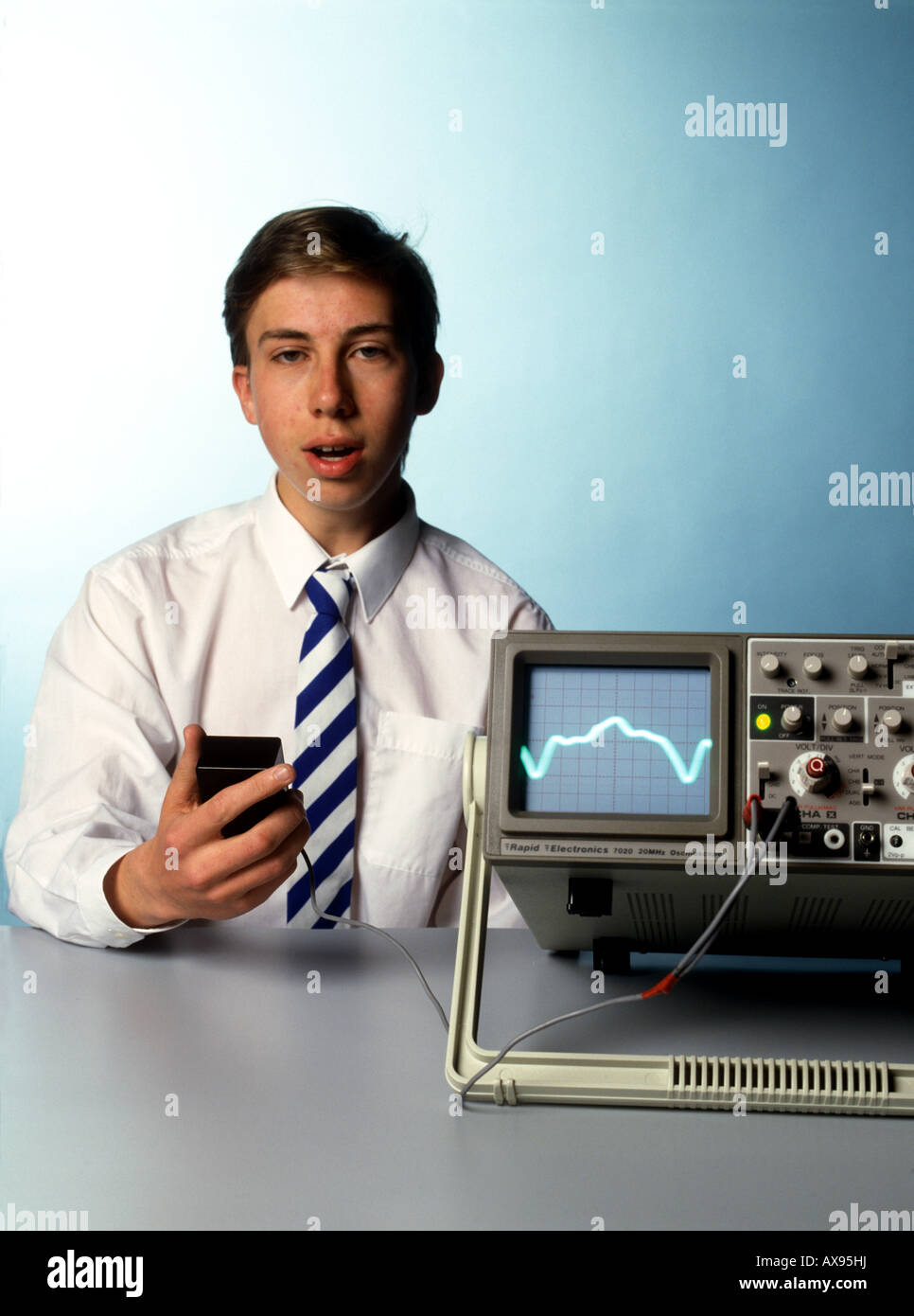 Cathode Ray Oscilloscope Stock Photos Cro A School Boy Sings Note Into Microphone And Its Waveform Is Shown On