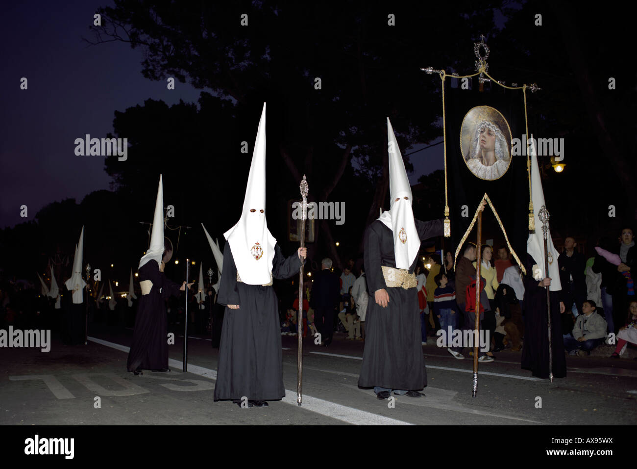 Penitents march at the Semana Santa parade, Malaga, Spain - Stock Image