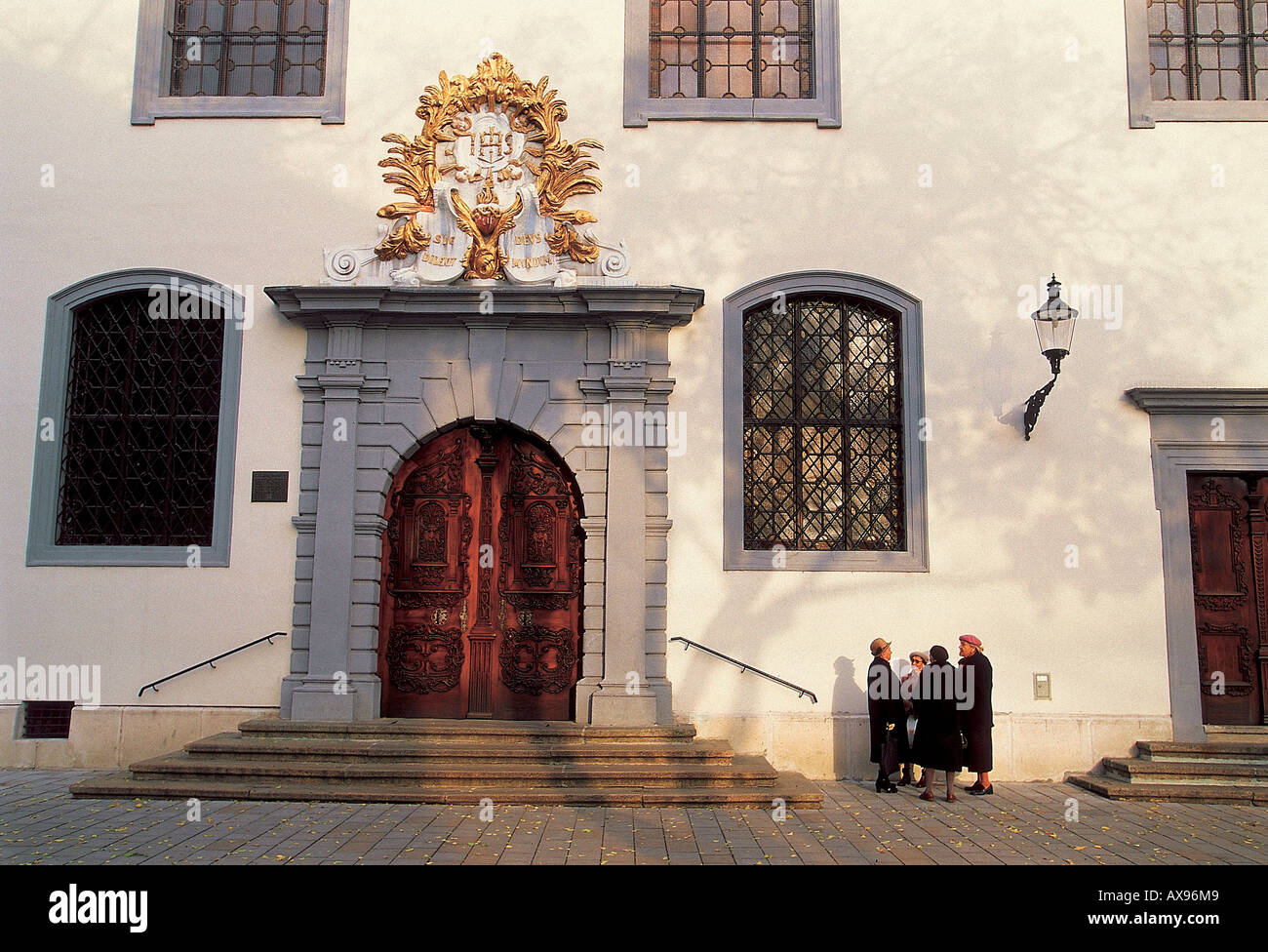 A group of old women in front of a building on Franciscan Square, Bratislava, Slovakia - Stock Image