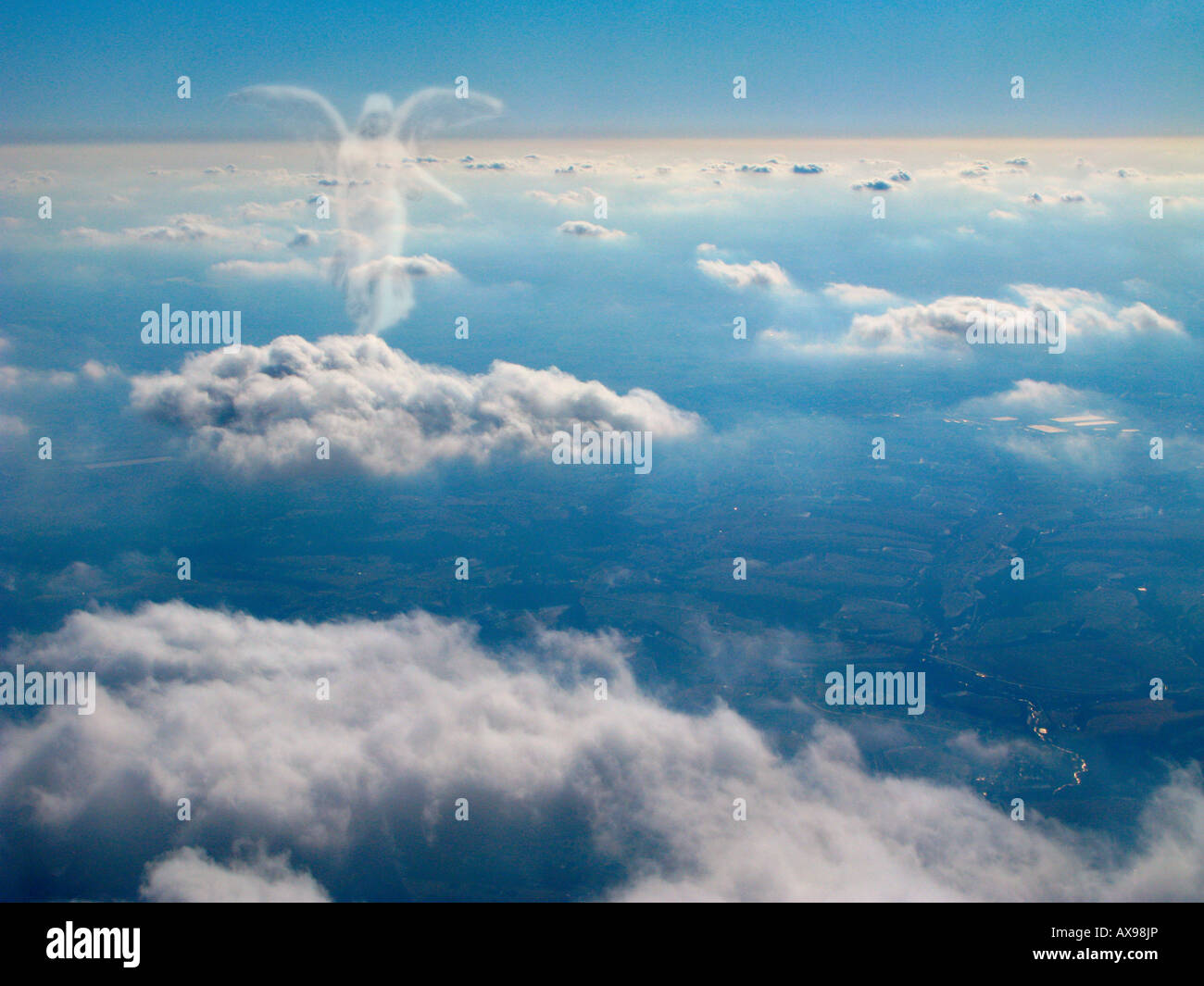 Spirit of an angel walks on top of the clouds. - Stock Image
