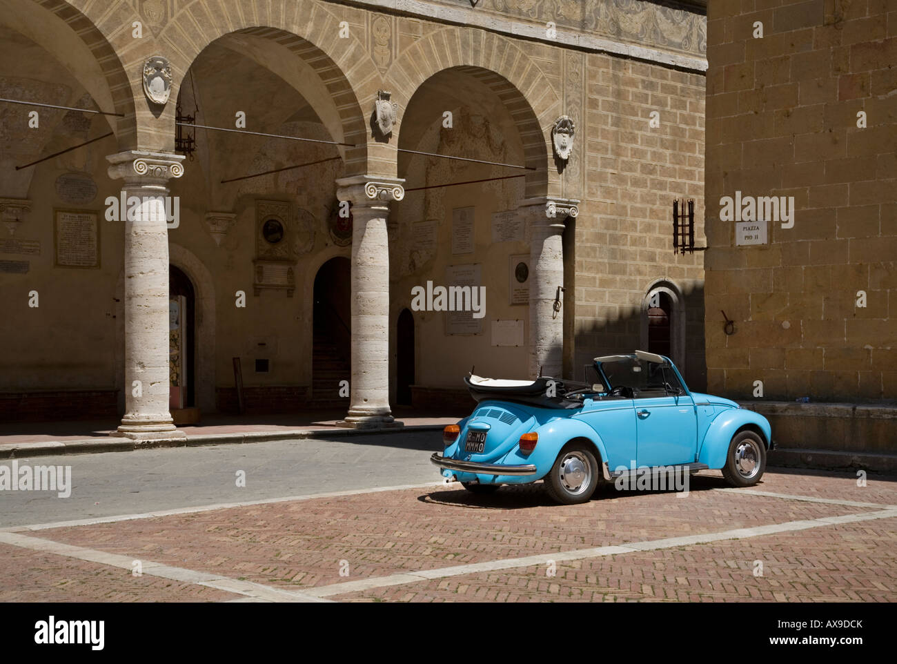 blue open top VW Beetle parked with its top down - Stock Image
