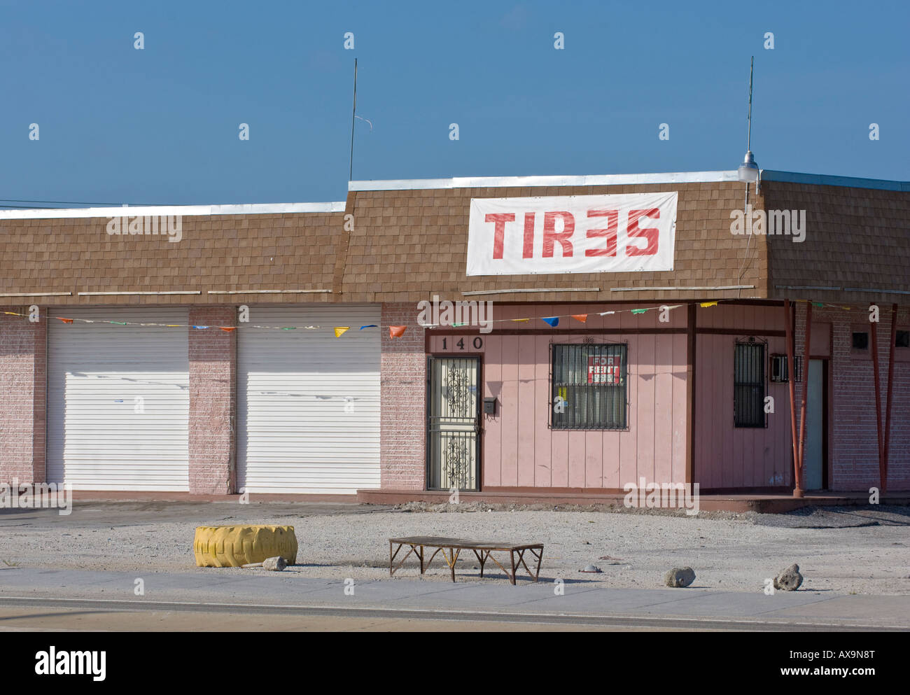 Americana tire changing rental commercial property business vacant closed fineshed - Stock Image