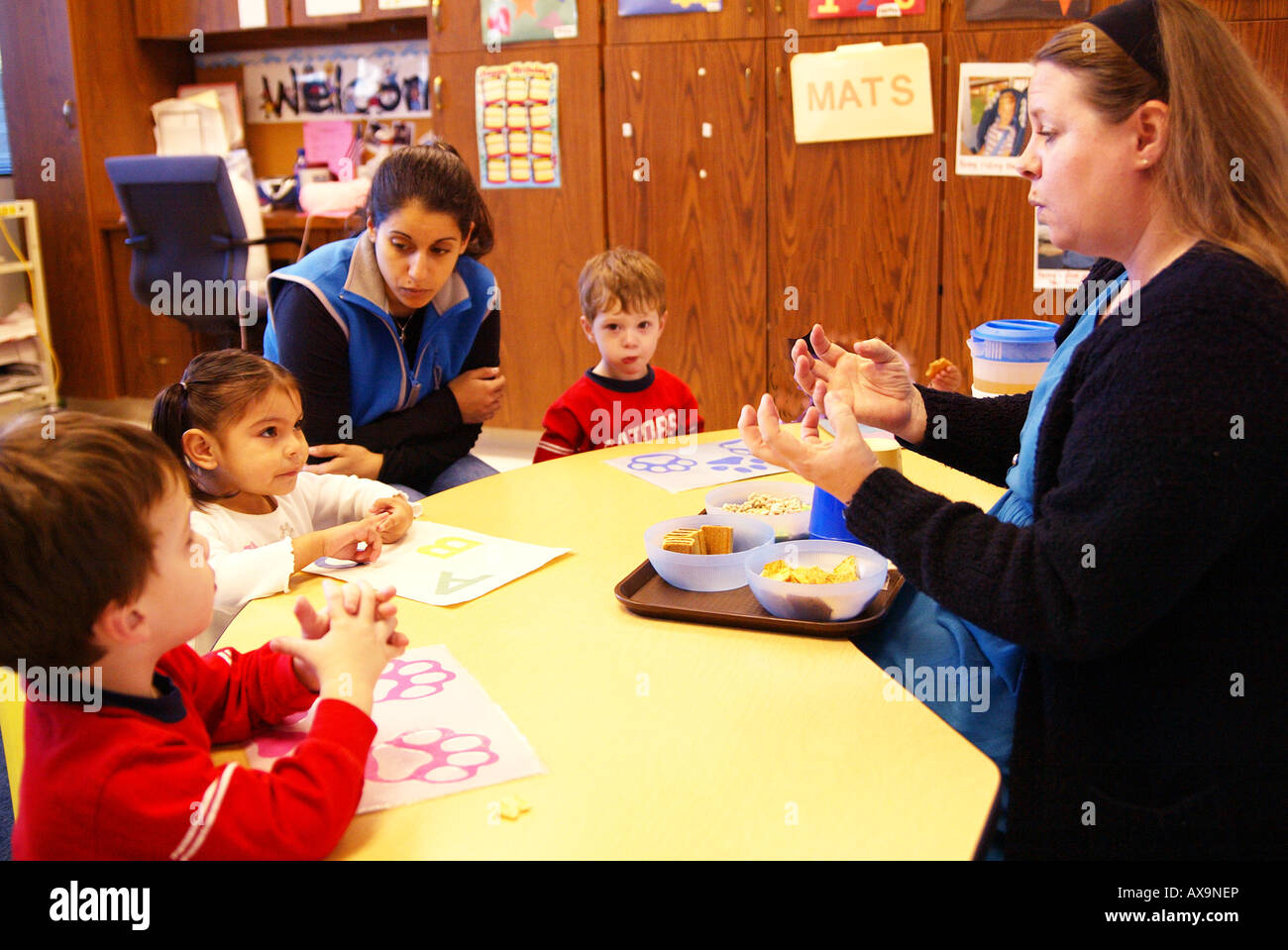 Therapist works with hearing impaired children at Providence Speech and Hearing Center Orange CA USA - Stock Image