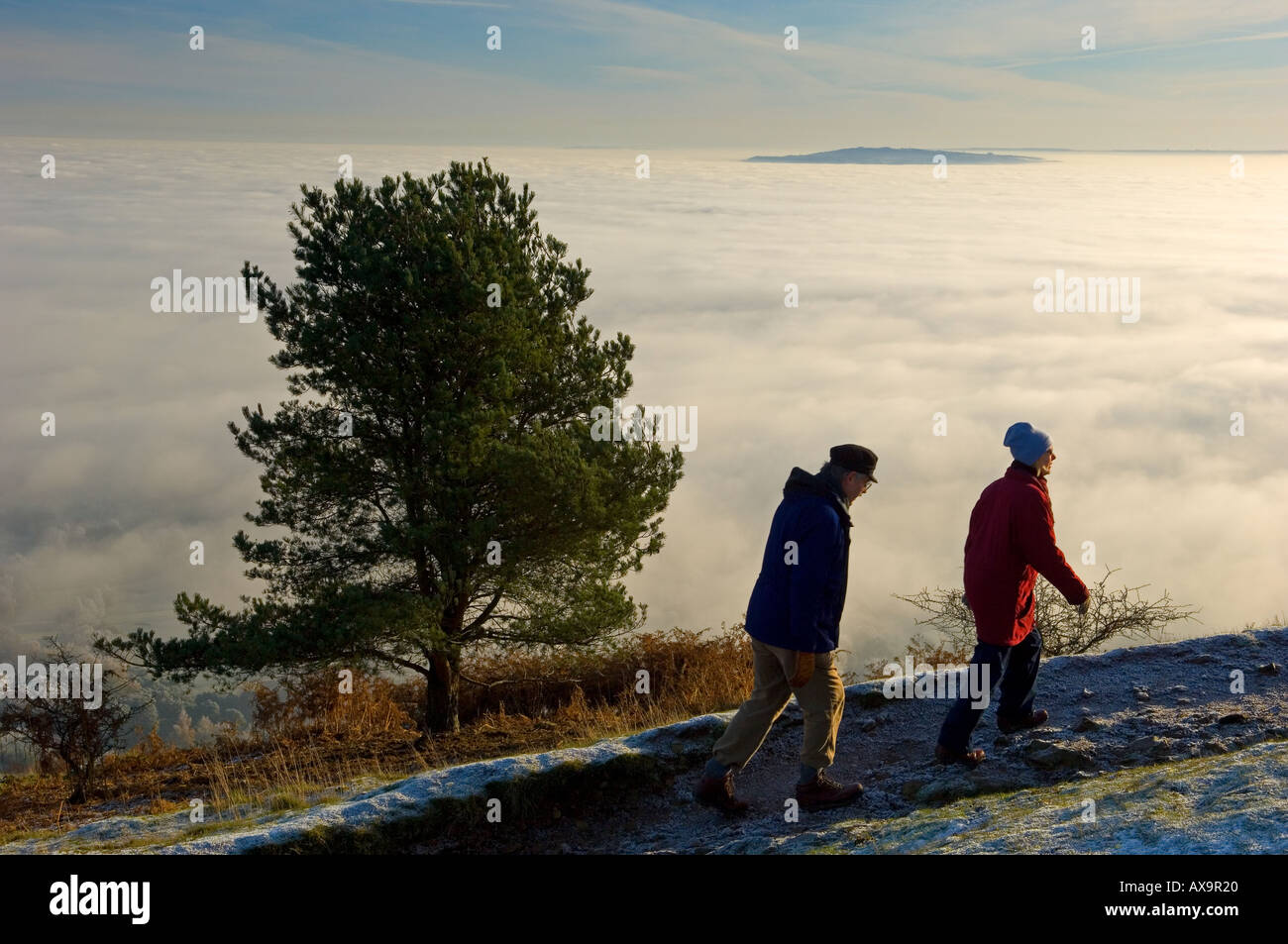 Walkers on the Malvern Hills shrouded in fog - Stock Image