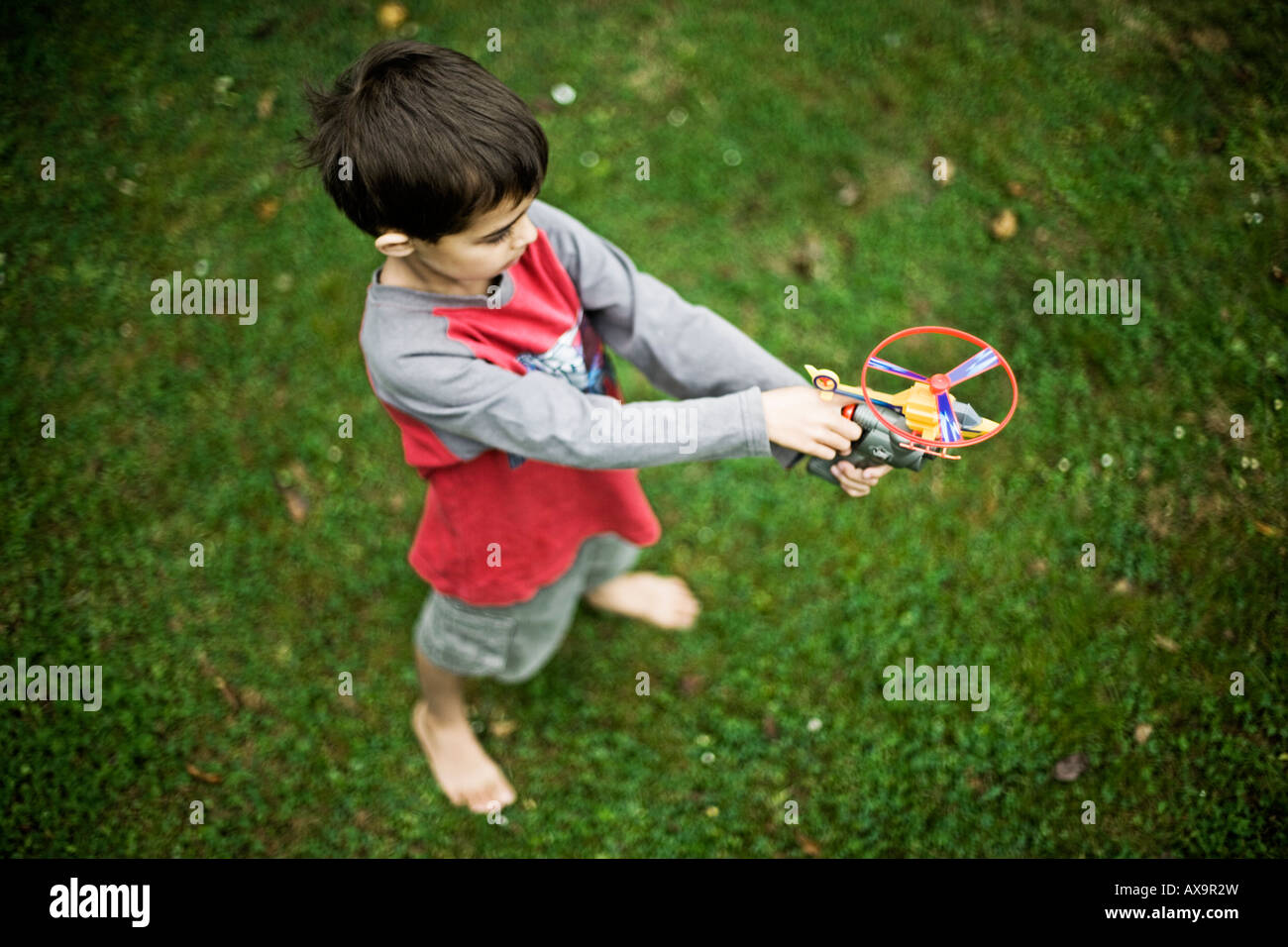 Boy with toy helicopter six years old Stock Photo