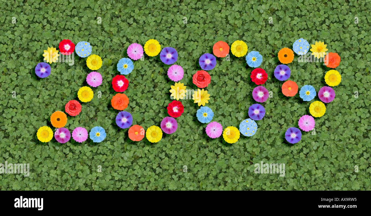 year written with flower heads - Stock Image