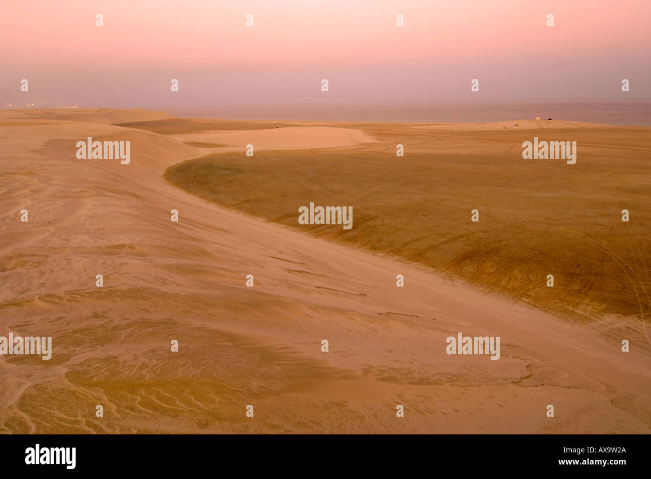 The Inland Sea 'Khor al Adaid' in southern Qatar at dusk. Qatar hopes to have the area declared a World Heritage site. - Stock Image
