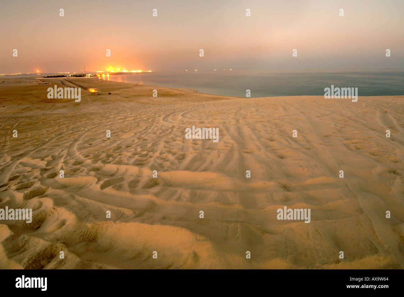 Industrial refinery seen from the Inland Sea (Khor al Adaid) in southern Qatar. - Stock Image