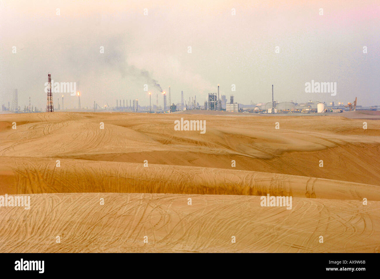 Industrial refinery seen from the Inland Sea 'Khor al Adaid' in southern Qatar. - Stock Image