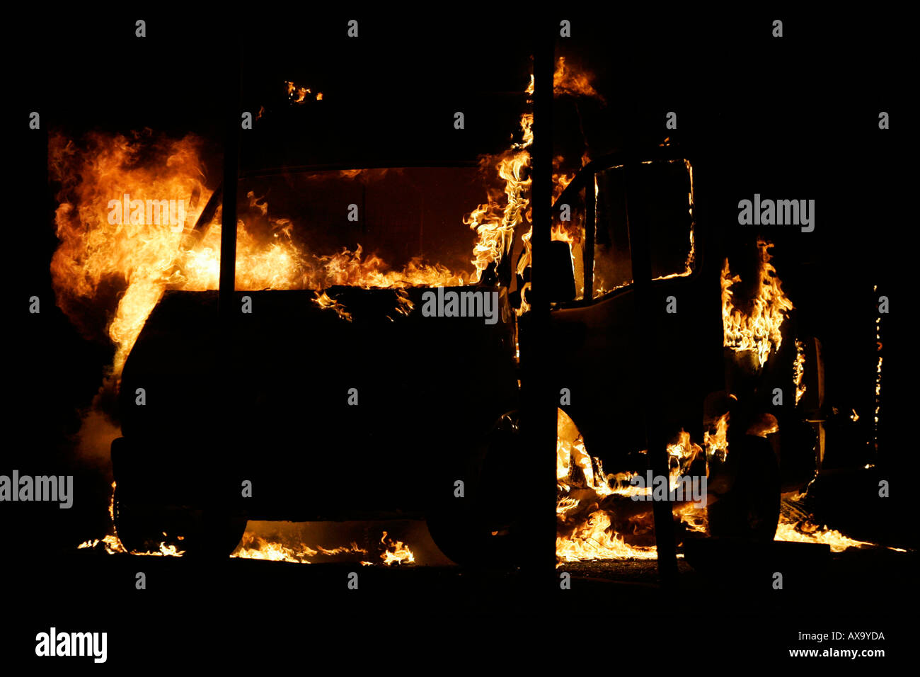 Van burning as roadblock during loyalist rioting and violence north belfast northern ireland - Stock Image