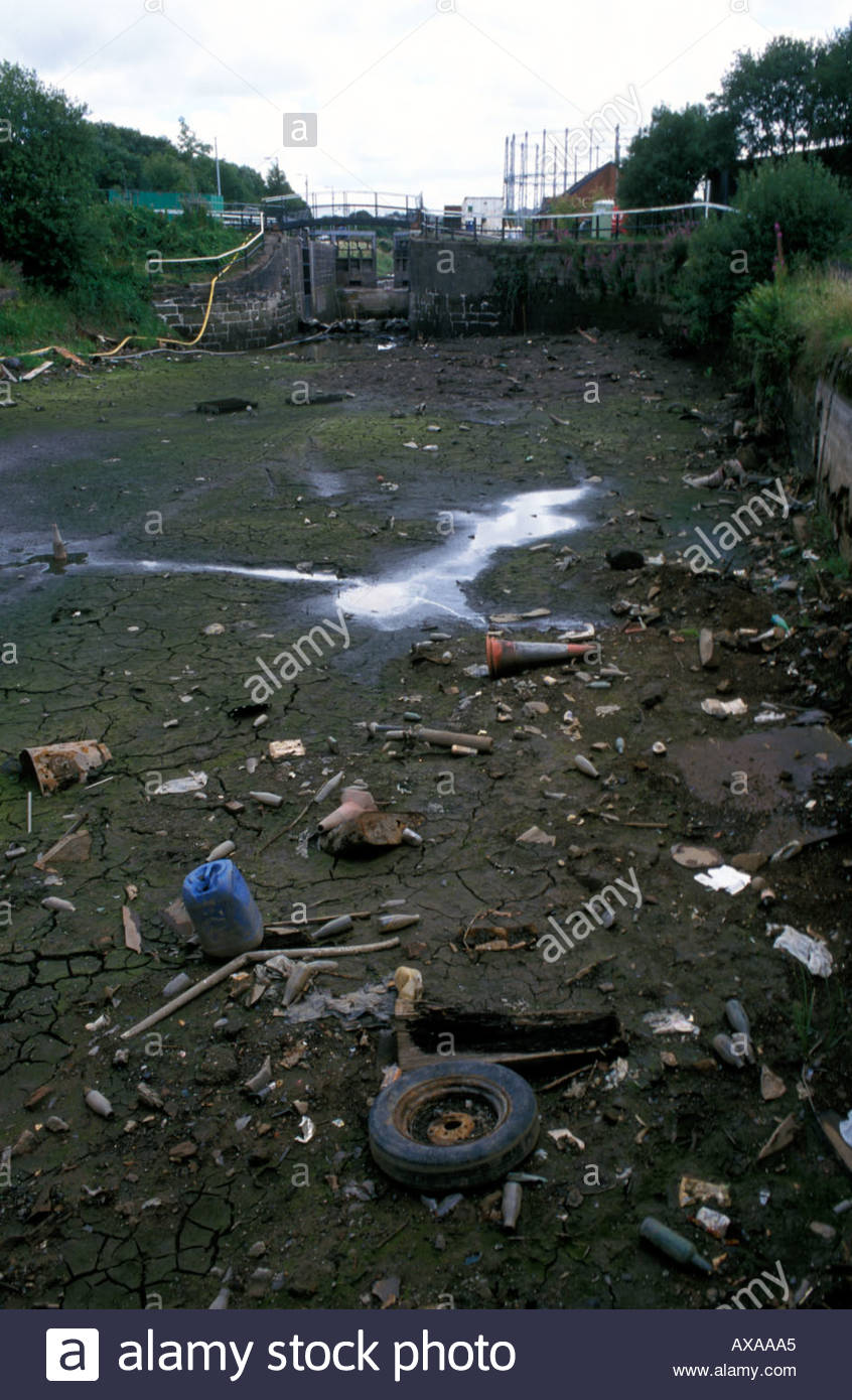 Debris on canal bed drained for repair work Forth Clyde Canal Glasgow Scotland - Stock Image