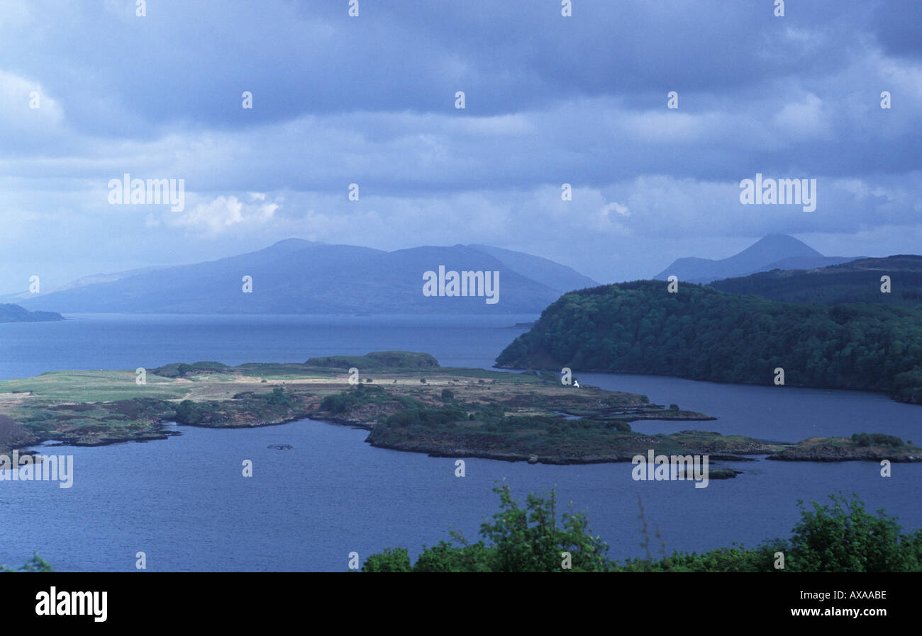 Harbour at Tobermory and Coastal Mountains on the mainland as viewed from the Isle of Mull with ocean in photograph - Stock Image