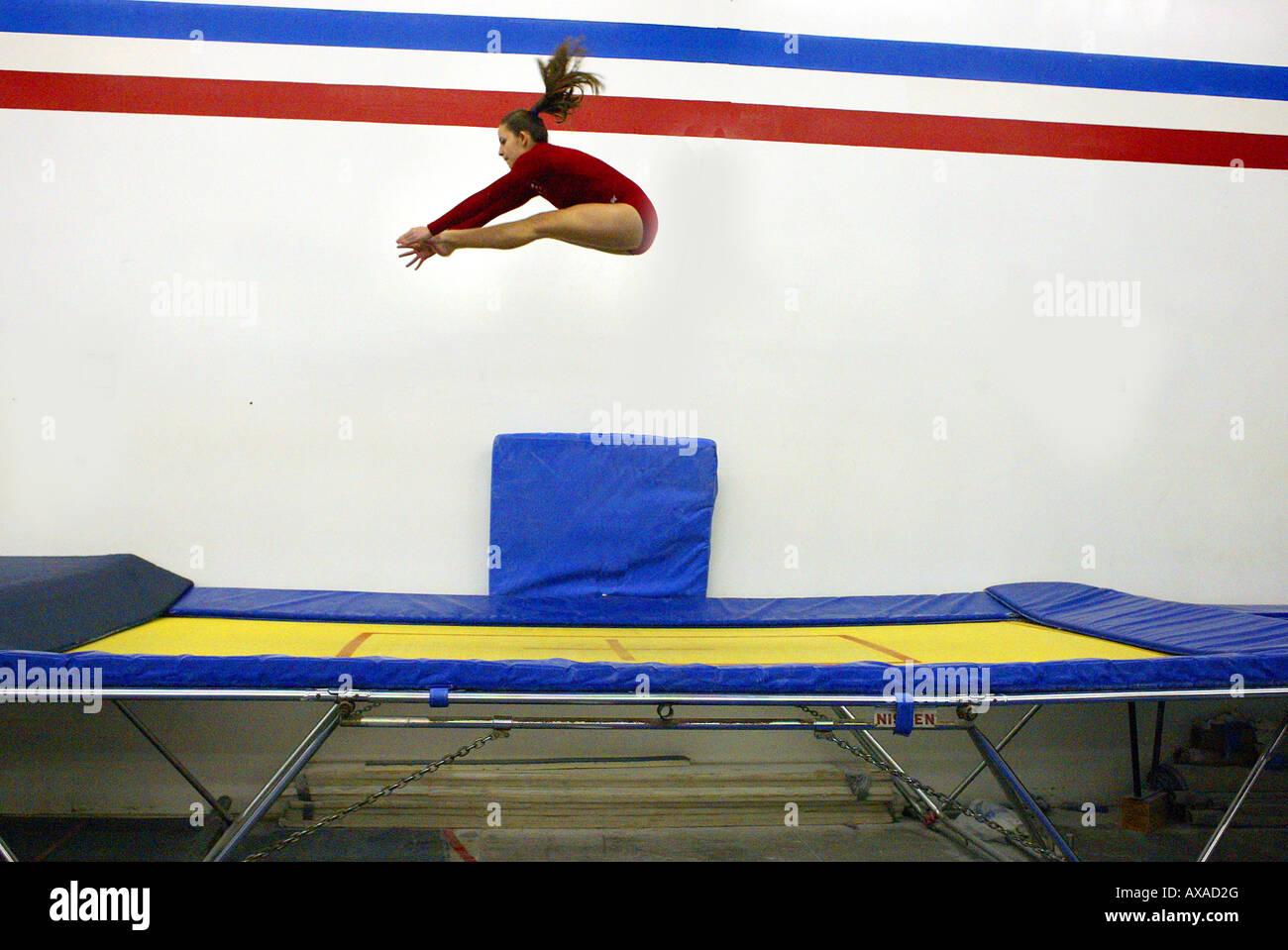 Teen Girl Performs On Trampoline In Gymnastics Center