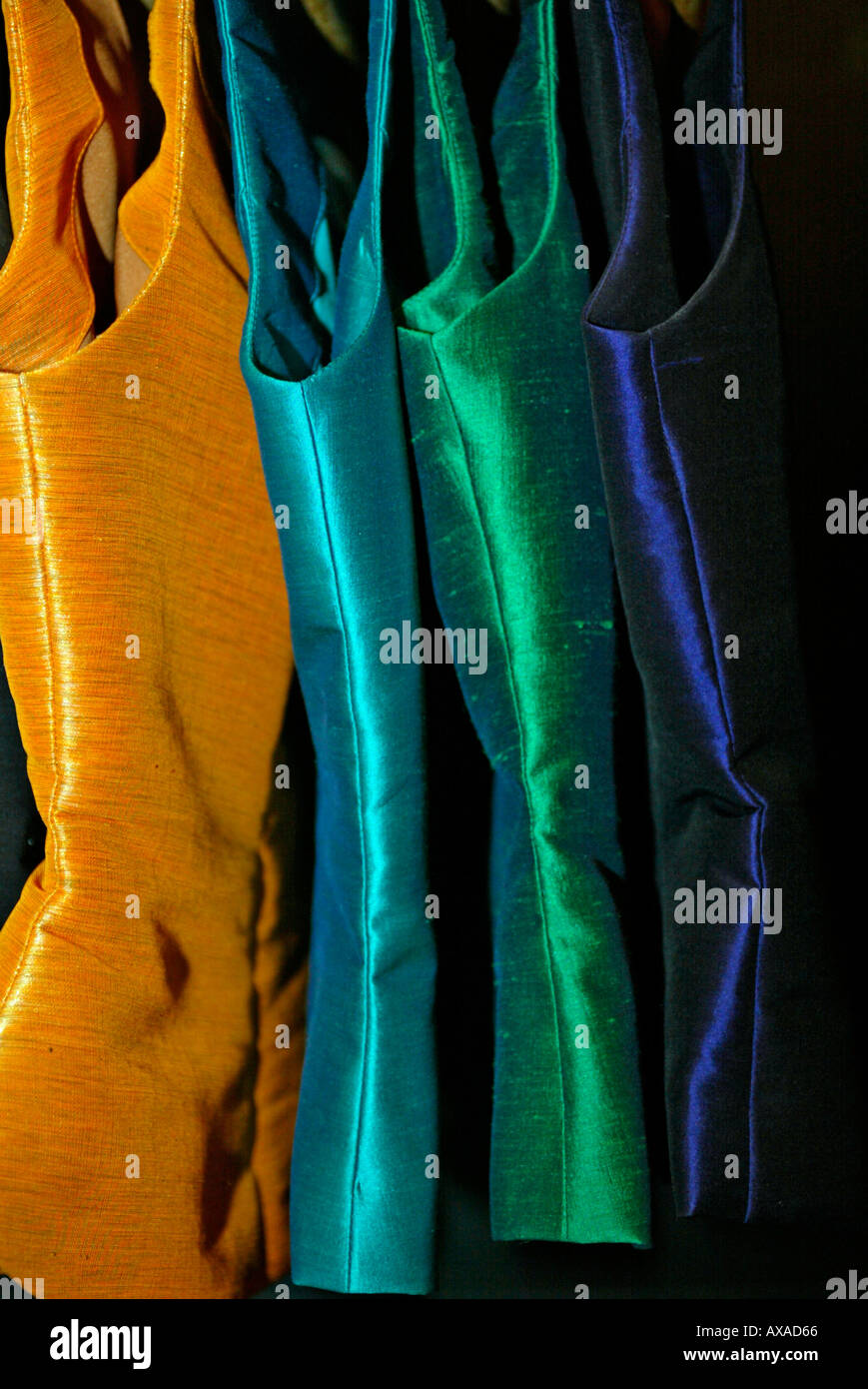 Coloured bodices in silk factory showroom Chiang Mai north Thailand - Stock Image