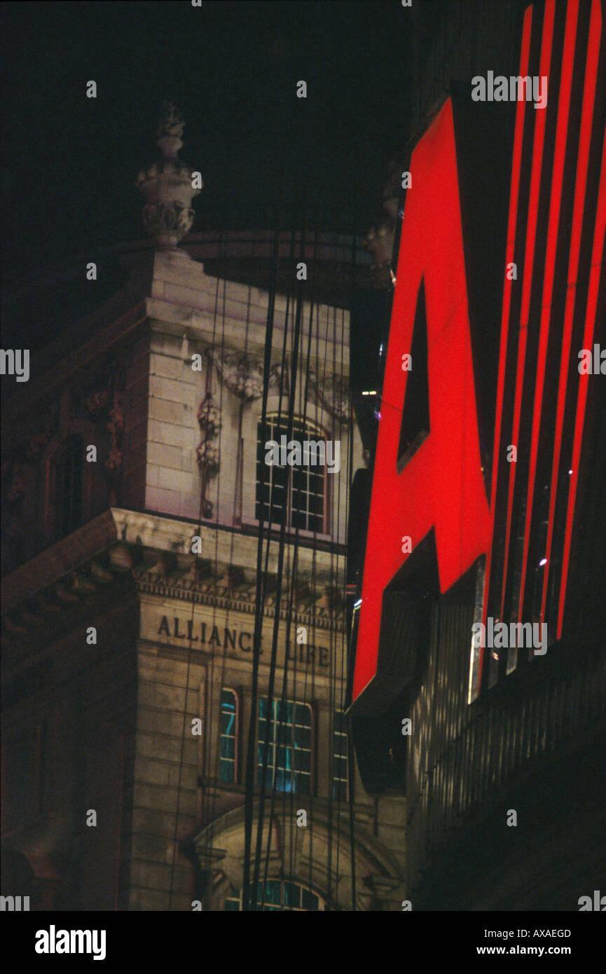 Illuminated advertising at night, Picadilly, London, UK - Stock Image