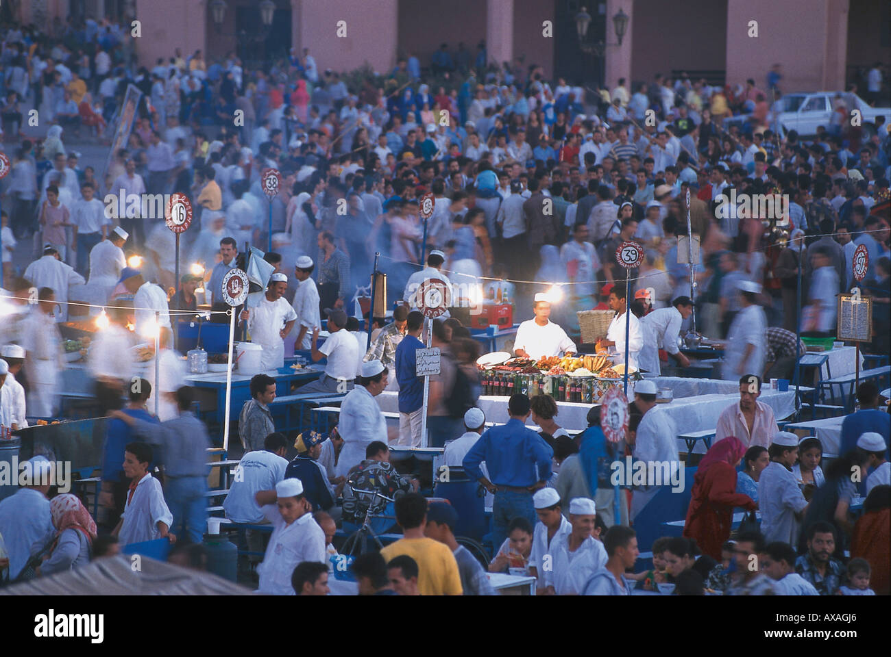 Crowd and cookshops on the Nightmarket, Djemaa el-Fna, Marrakech, Morocco - Stock Image