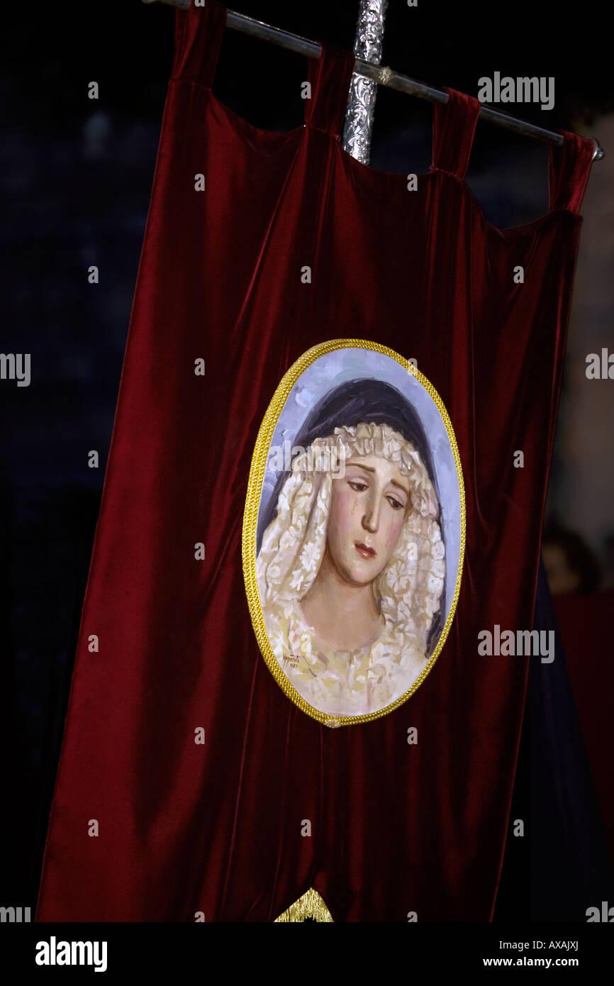 Banner of weeping Virgin Mary at the Semana Santa parade, Malaga, Spain - Stock Image