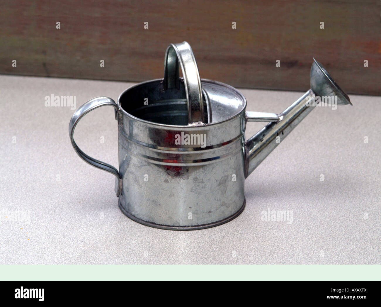 Small galvanized watering can suitable for a child - Stock Image