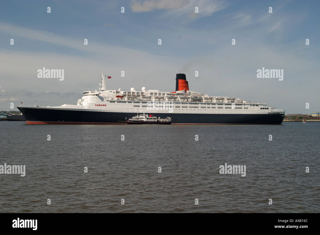 The QE2 anchored in the River Mersey - Stock Image