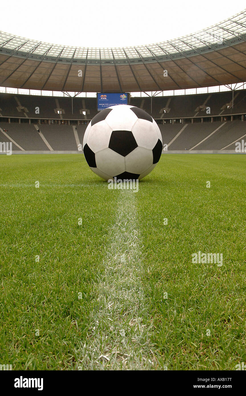 A soccer ball in a football stadium - Stock Image