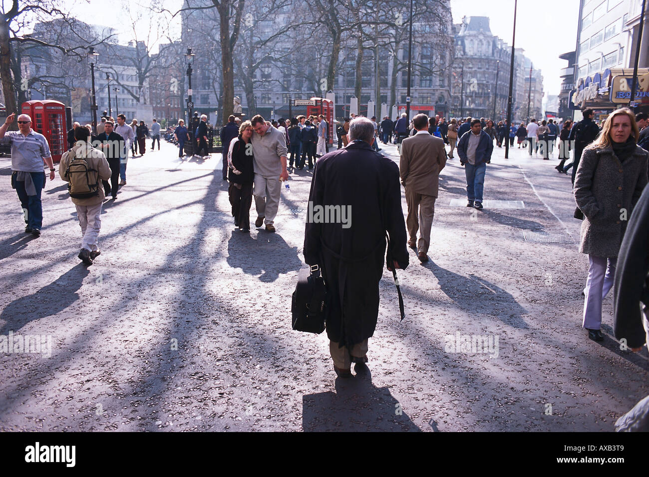 Passers-by in the Leicester Square in autmn, London, England, Great Britain - Stock Image
