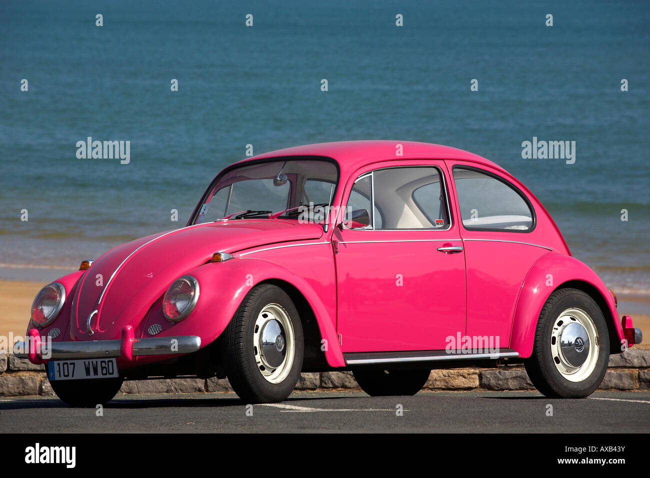 pink vw beetle chippy cox france. owner release ok stock photo