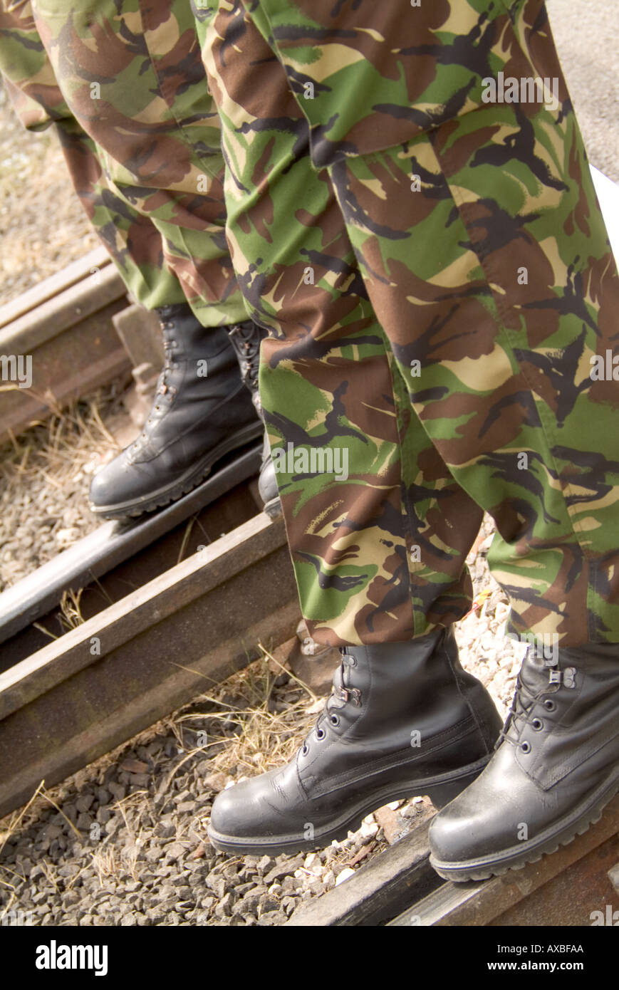 soldier army miltary fight war camo camoflarge boots railway line guard town police action peace time armed forces jack boot - Stock Image