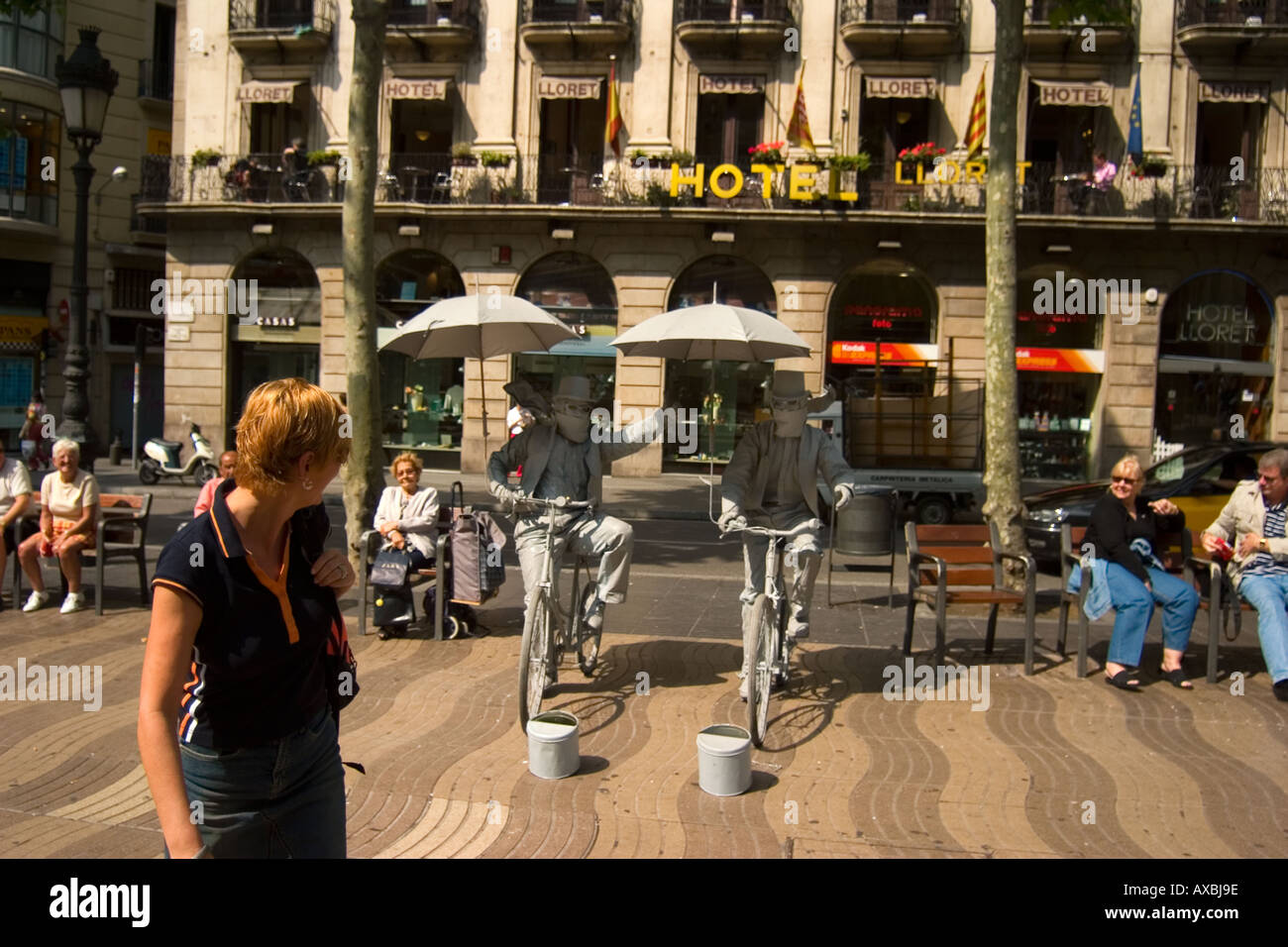 spain Barcelona Las ramblas street artists funny entertainer on bicycles - Stock Image