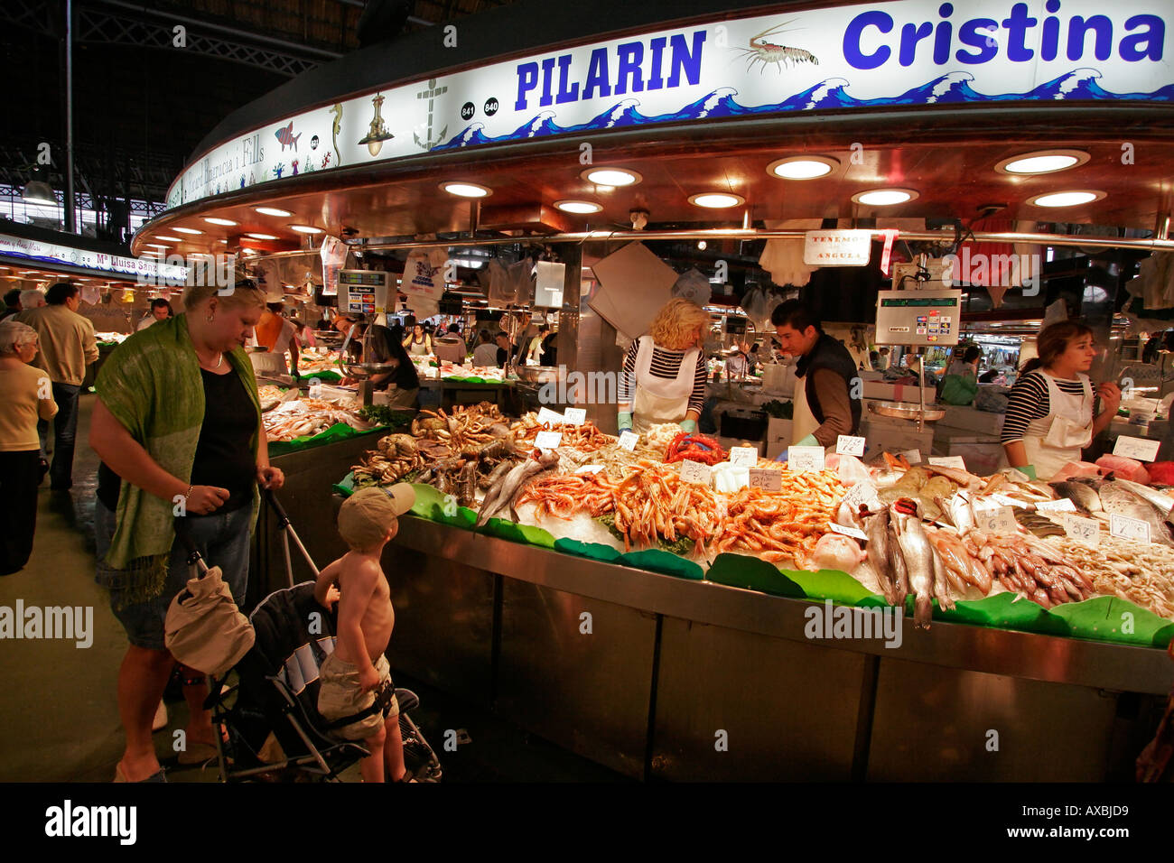 Spain Barcelona Market hall Mercat de la Boqueria fresh fish seefood saleswoman - Stock Image
