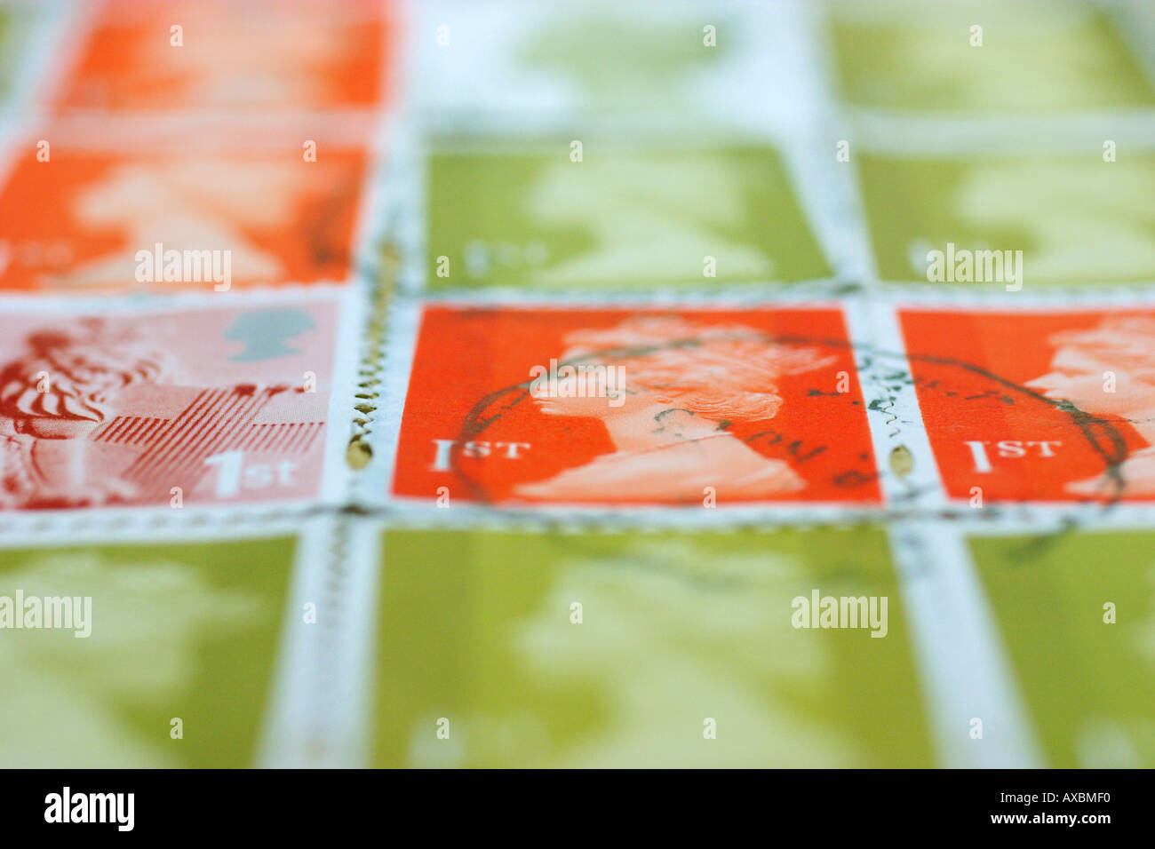 Low angle view of a set of used 1st class stamps - Stock Image