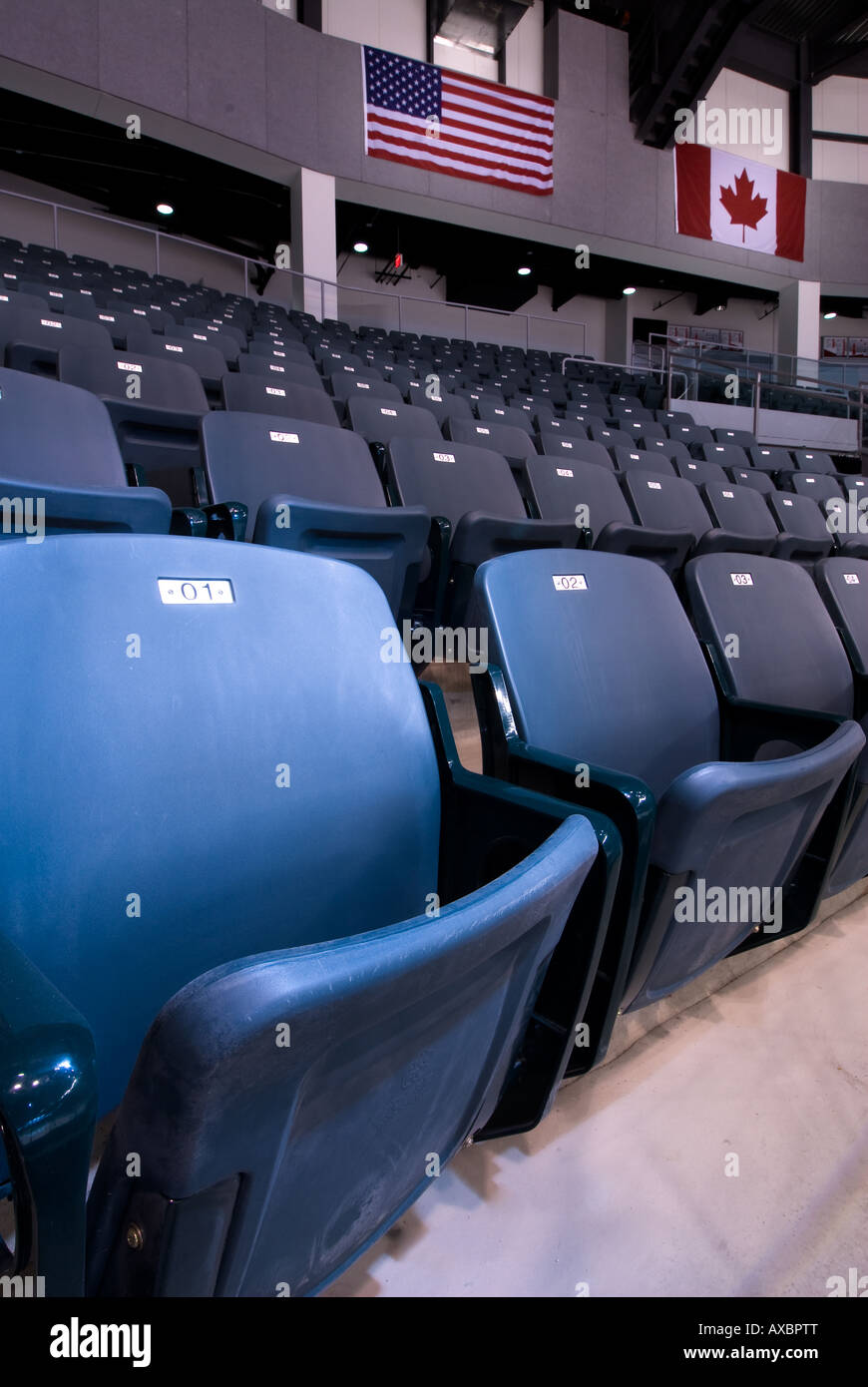 A row of spectator seats with American and Canadian flags at Kingstons newly built K Rock Centre Feb 25th 2008 - Stock Image