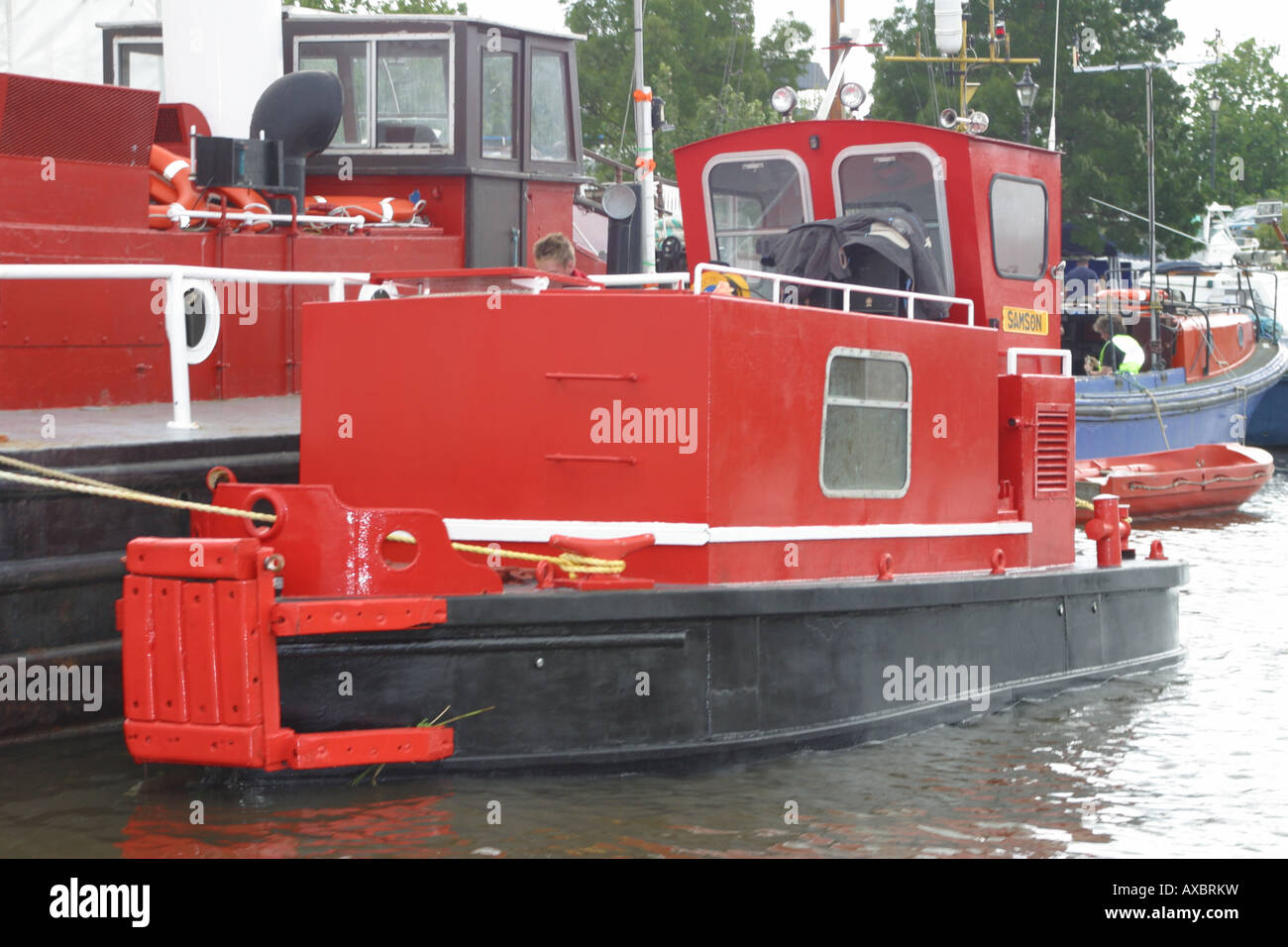 red tug rescue toeing boat boating floating moored maidstone kent england uk - Stock Image