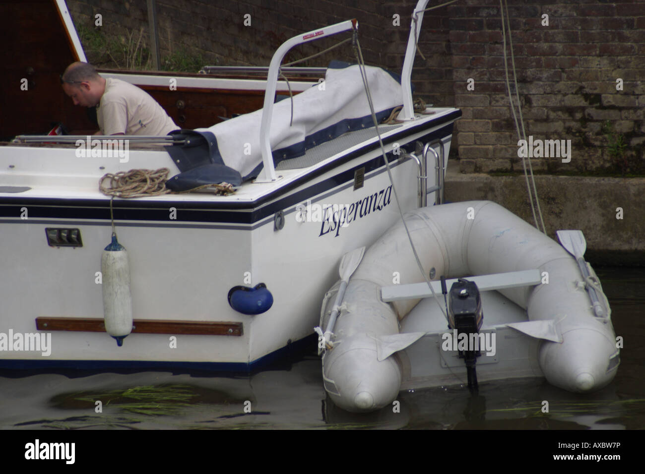 white stern leisure boat tender dinghy moored river medway maidstone kent england - Stock Image