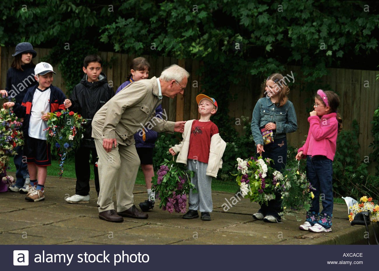 Youngsters rehearsing for the arrival of of the May Queen in Moulton, UK - Stock Image