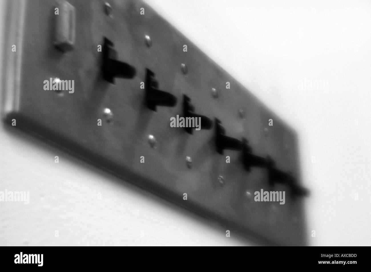 A row of ligh switches switch in an office - Stock Image