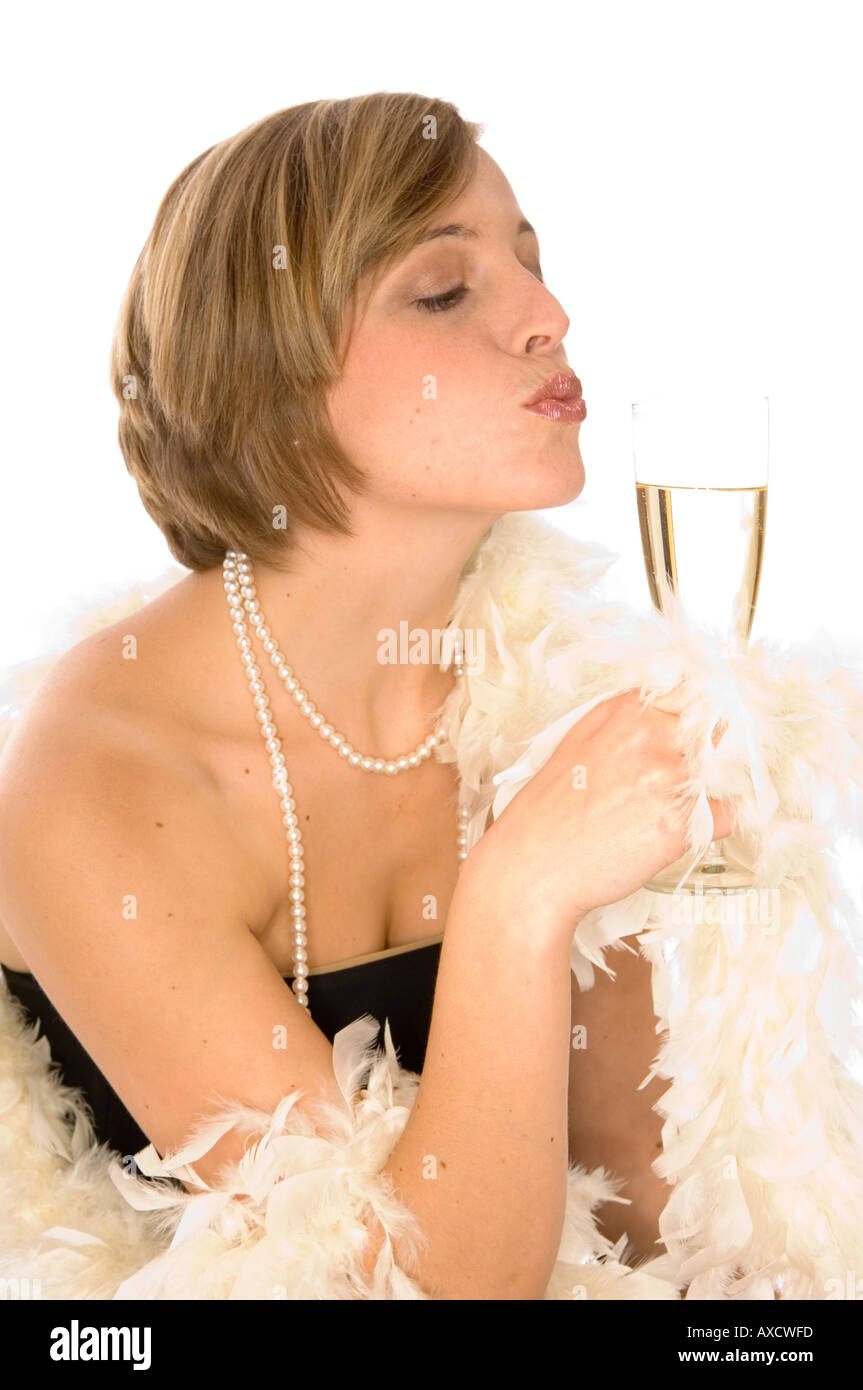 7358e477893 young woman in black cocktail dress with feather boa and champagne glass  kissing lips