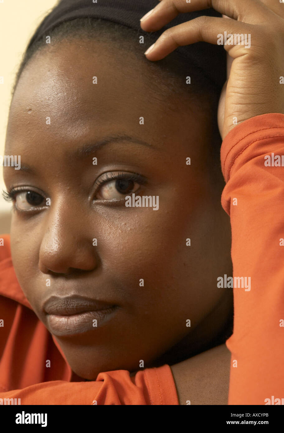 portrait of African female in early twenties eye contact - Stock Image