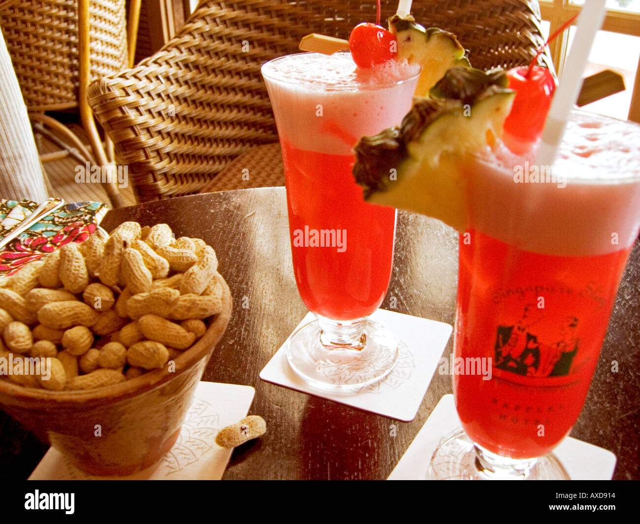 Singapore Sling Cocktail And Peanut Bowl At The Long Bar Raffles Stock Photo Alamy