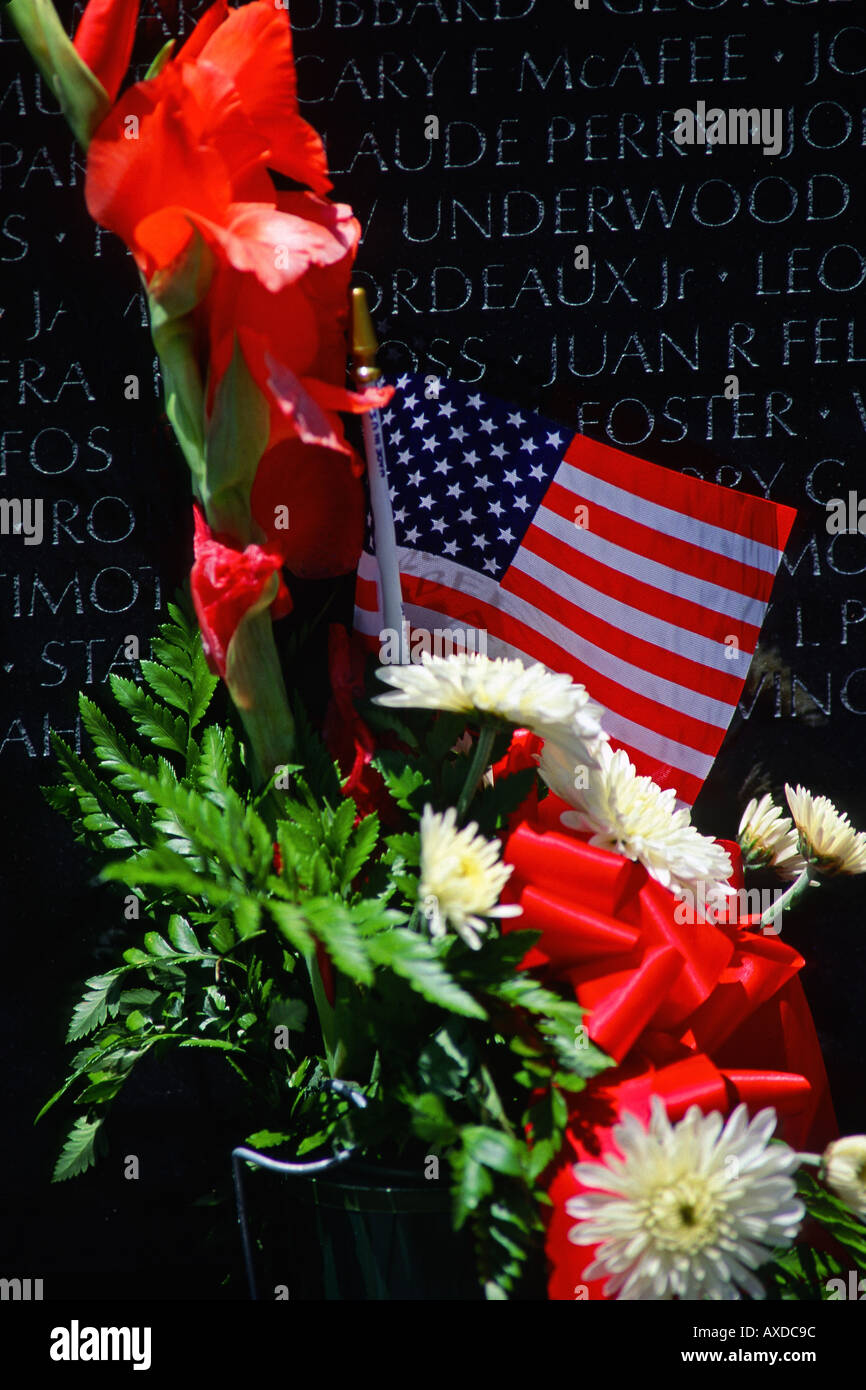 Red and white flowers and usa flag at vietnam memorial wall in stock red and white flowers and usa flag at vietnam memorial wall in washington dc usa mightylinksfo