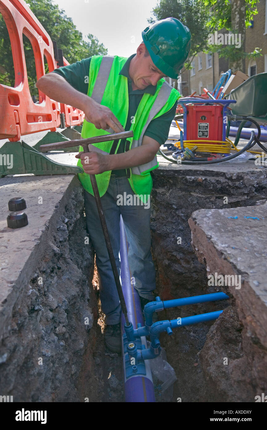 Rehabilitating a cityu0027s water supply by replacing underground Victorian cast iron pipe system with modern polyethylene tubing. & Rehabilitating a cityu0027s water supply by replacing underground Stock ...