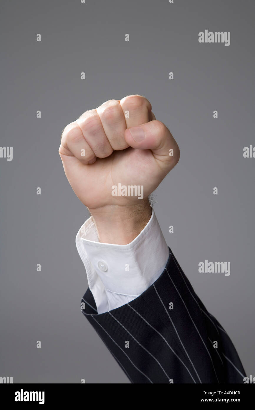 Man making hand gesture, fist, close-up - Stock Image