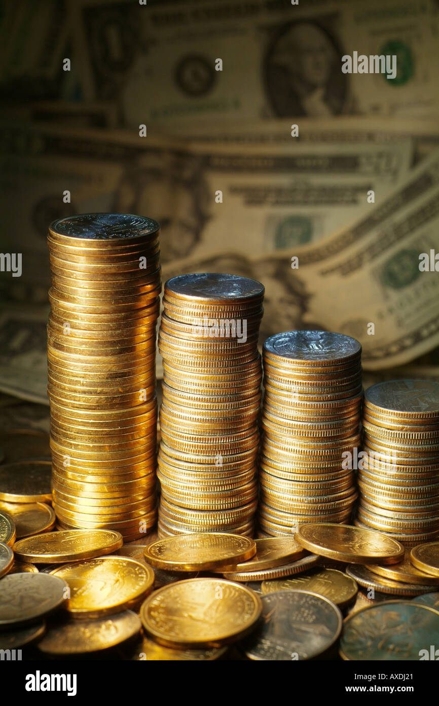 Coins and dollars wealth and riches concept Dollar coins along with quarters and bank notes. US money - Stock Image