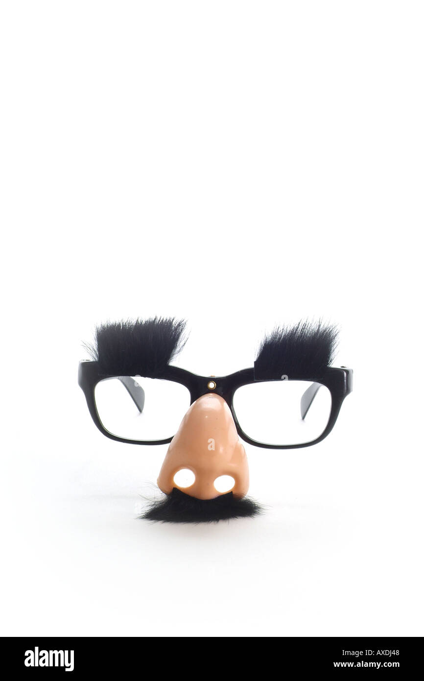 'Humour concept' glasses with mustache eyebrows on a white background. Groucho Marx style glasses. Disguise - Stock Image