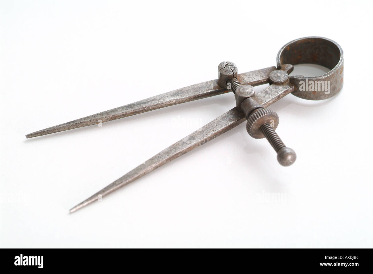 Antique Drafting Tool on White Background compass - Stock Image
