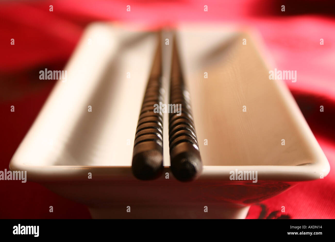 Chopsticks on a bowl in a formal dinner setting Stock Photo